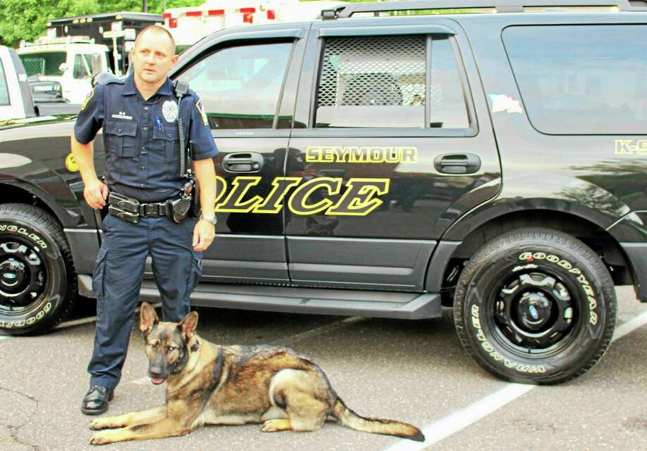 Officer John Oczkowski and police K-9 Sage. Photo: Jean Falbo-Sosnovich — New Haven Register