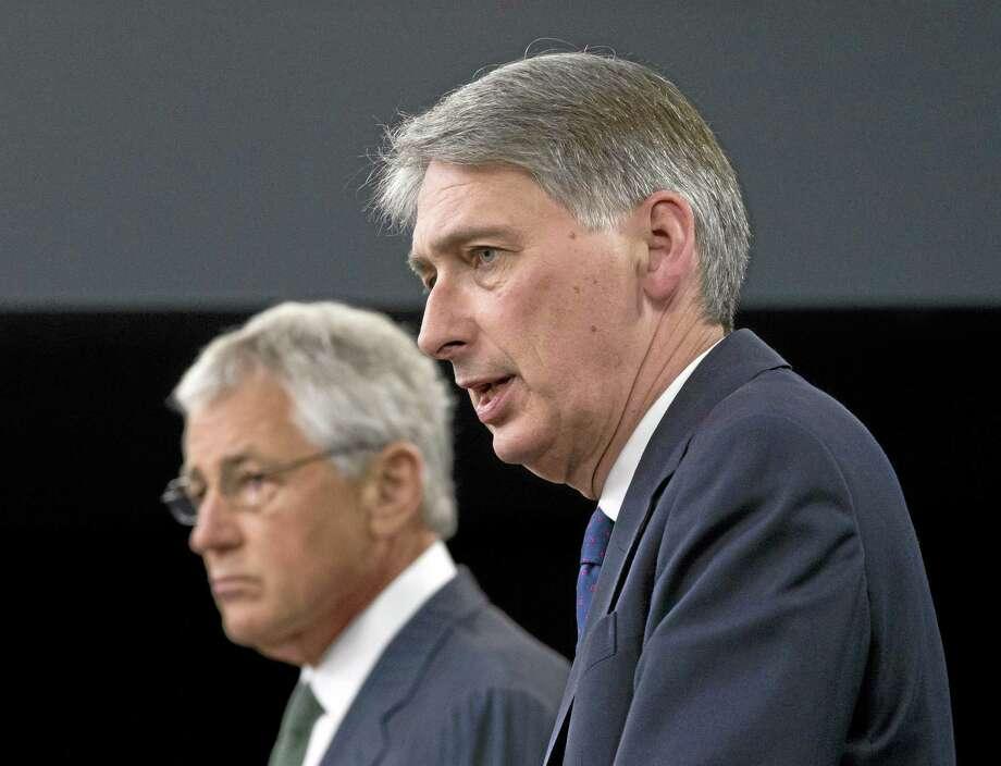 From left, Defense Secretary Chuck Hagel and British Defense Secretary Philip Hammond Photo: File   / AP