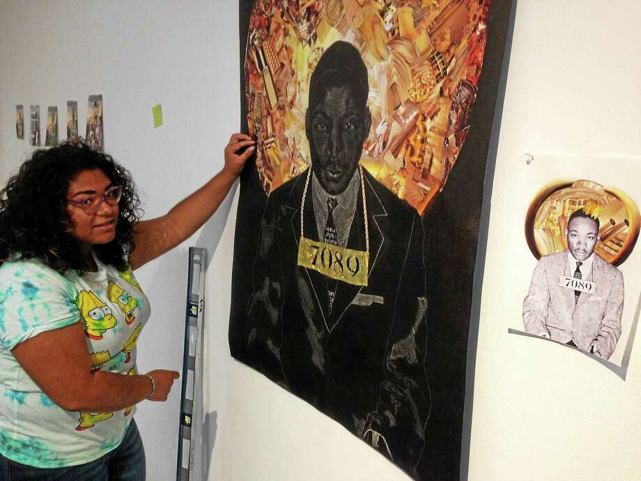 Arianna Alamo with her artwork showing Martin Luther King. Photo: JOE AMARANTE — NEW HAVEN REGISTER
