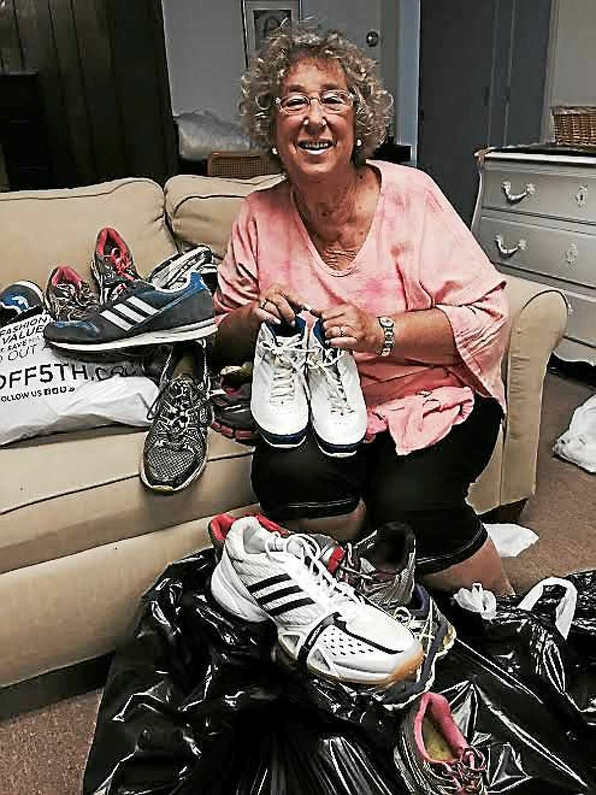 Martha Weisbart of Orange, who is collecting sneakers at the JCC for Brenda and John Adkins' sneaker drive.