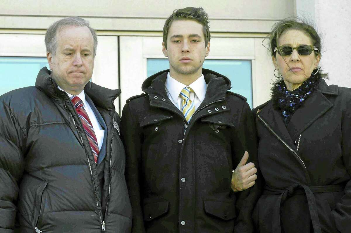 In this Feb. 25 photo, former Wesleyan University sophomore Zachary Kramer leaves Superior Court in Middletown with his parents after his arraignment for possession of controlled substances and other charges.
