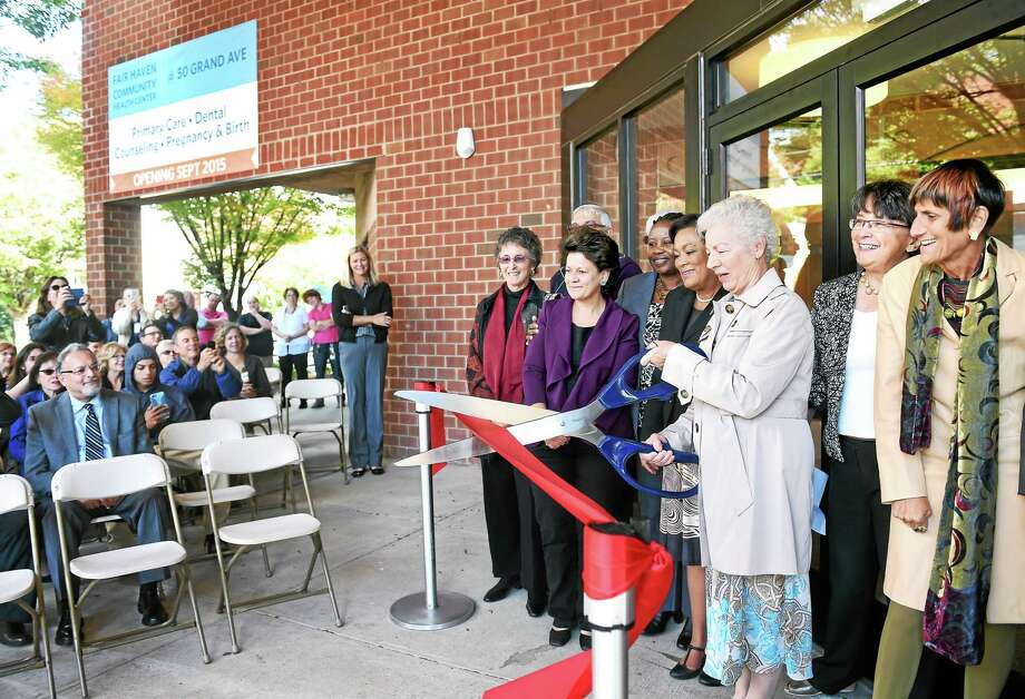 Maria Melendez, right, cuts the ribbon for the Fair Haven Community Health Center satellite at 50 Grand Ave. in the Fair Haven section of New Haven Friday. Photo: Arnold Gold — New Haven Register