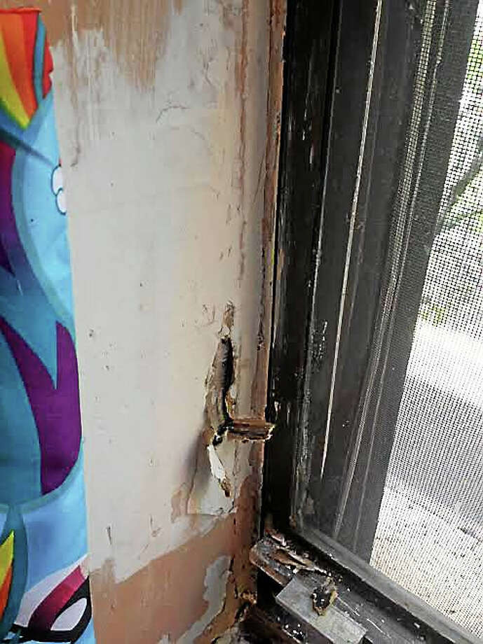 Water damage near a window at a Great Green apartment at Church Street South. Photo: Mary O'Leary — New Haven Register