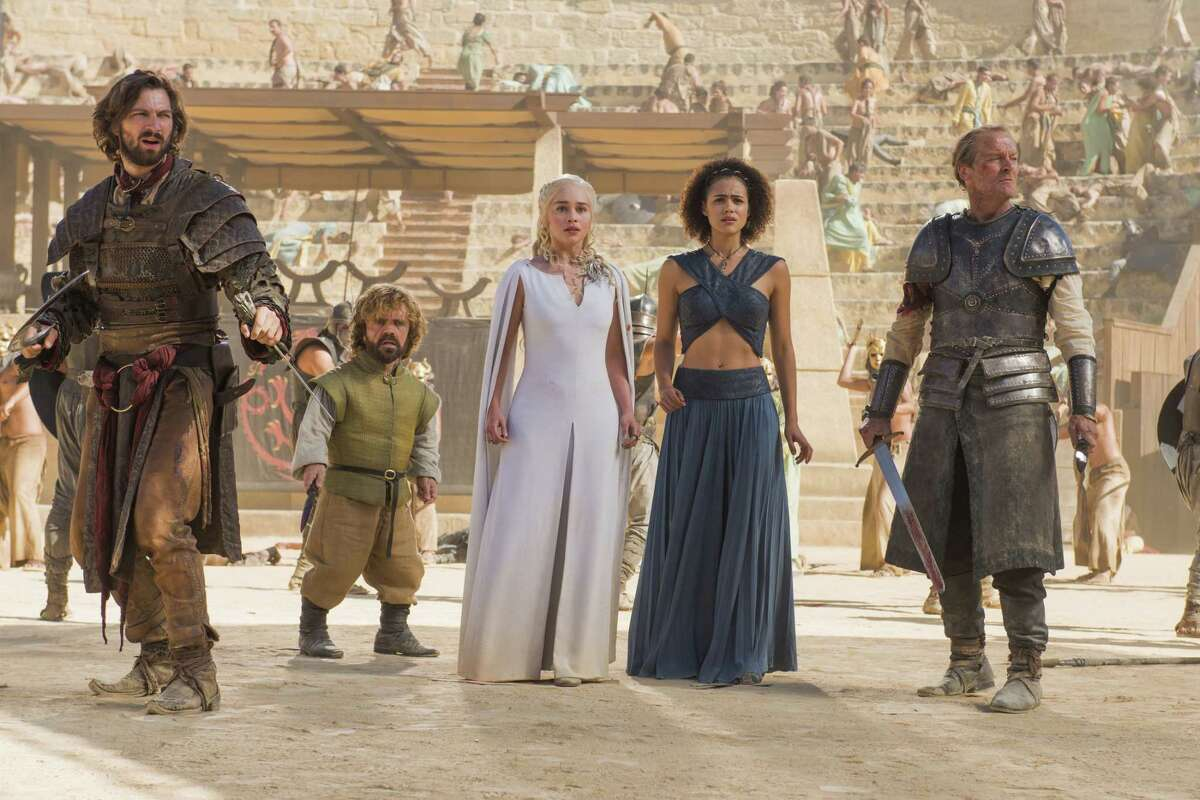 """This photo provided by courtesy of HBO shows, Michiel Huisman, from left, Peter Dinklage, Emilia Clarke, Nathalie Emmanuel, and Iain Glen, in a scene from """"Game of Thrones,"""" season 5."""