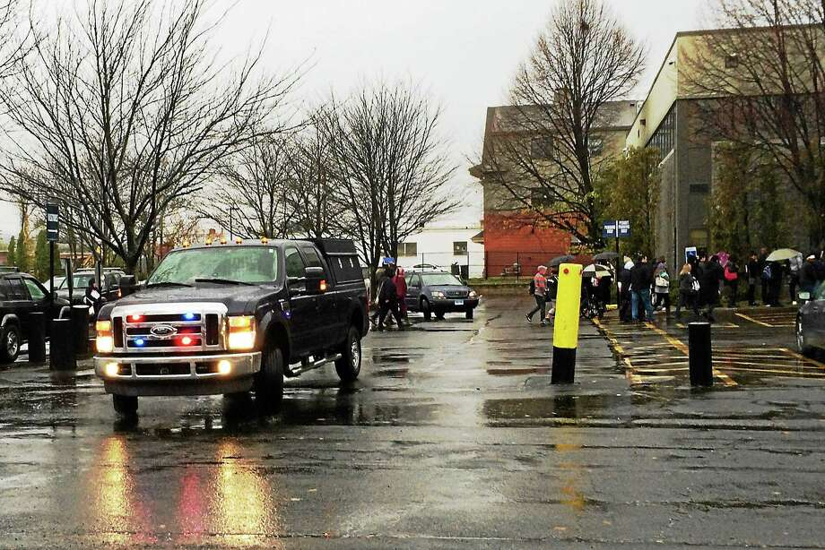 New Haven police and the bomb squad responded and the New Haven Adult Education Center was evacuated Thursday morning after someone reported a bomb near a trashcan in the area. Columbus House was also evacuated. Photo: Wes Duplantier — New Haven Register