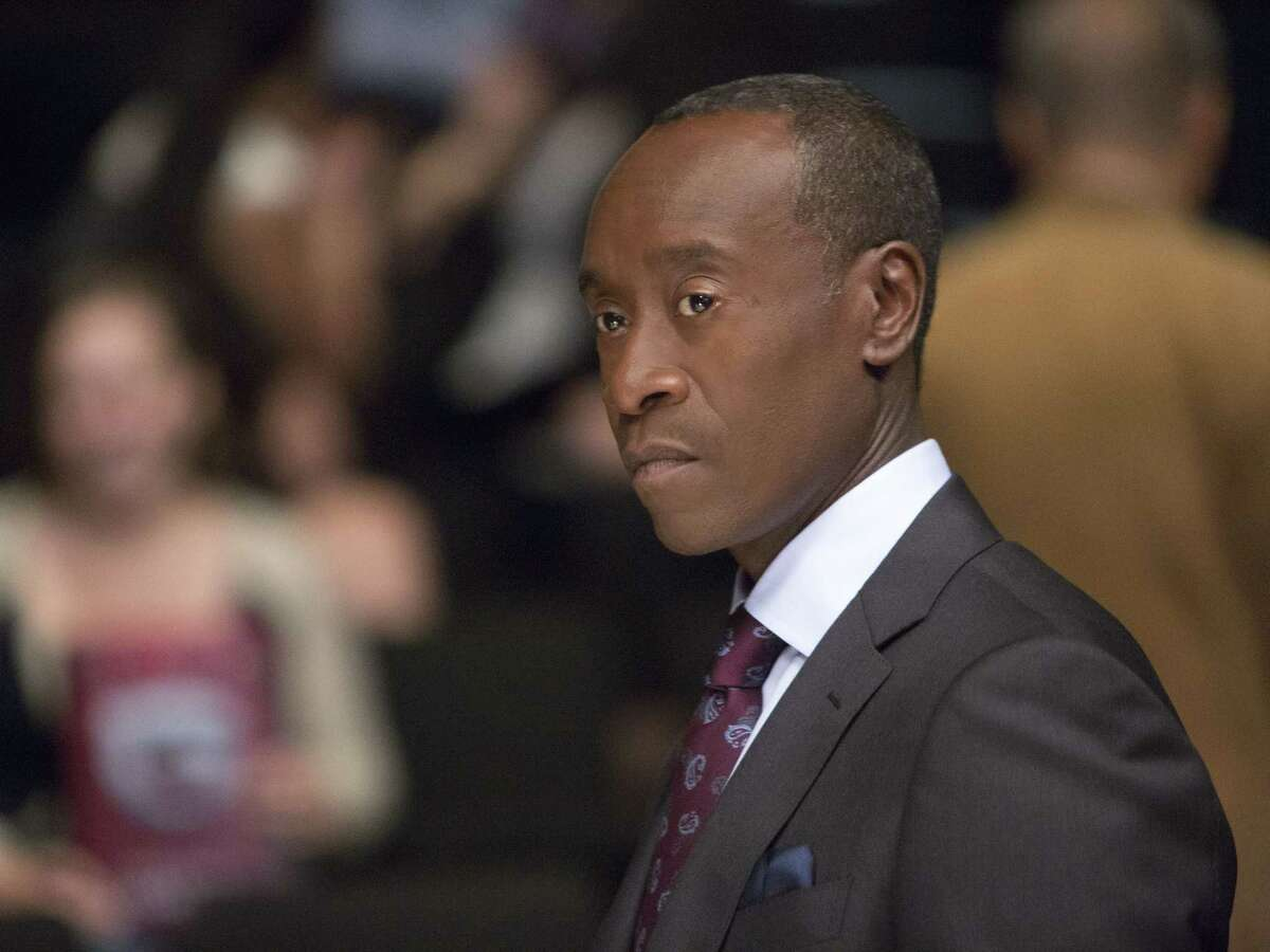 """In this image released by Showtime, Don Cheadle portrays Marty Kaan in a scene from """"House of Lies."""" Cheadle was nominated for an Emmy Award on Thursday, July 16, 2015, for outstanding lead actor in a comedy series for his role on the show."""