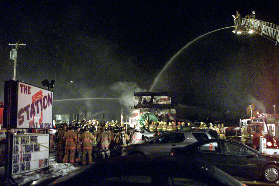 In this Feb. 20, 2003 file photo, firefighters spray water on to the charred nightclub, The Station, where 100 people were killed and more than 200 people were injured in West Warwick, R.I. Photo: Associated Press   / FR56276 AP