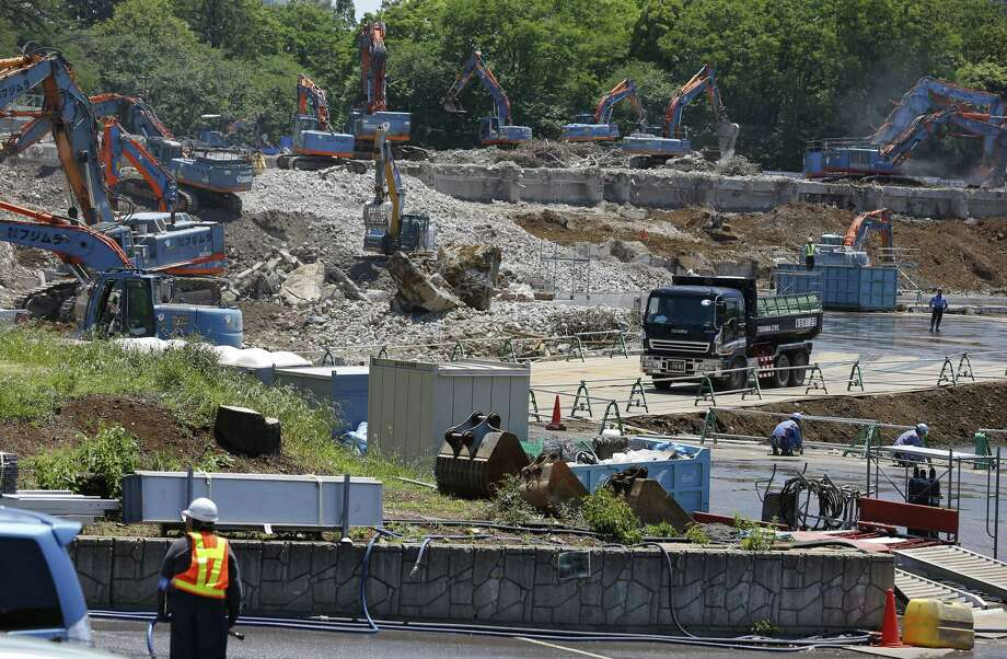 In this May 13, 2015 photo, Japan's National Stadium is dismantled for the renovation for the 2020 Tokyo Olympic Games, in Tokyo. Now, Tokyo's planned National Stadium for the 2020 Olympics will be the first to reach $2 billion, according to the latest cost estimate. Photo: AP Photo/Shizuo Kambayashi, File   / AP