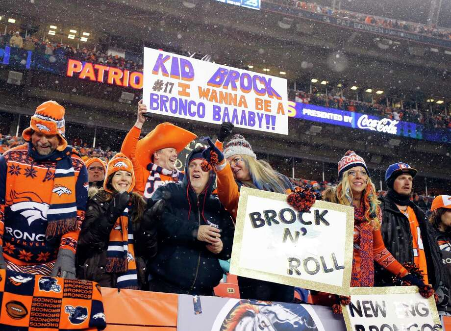 Denver Broncos fans hold signs in support of quarterback Brock Osweiler during a recent game. The Register's Dan Nowak likes the Broncos as one of three home favorites he will be keying on today. Photo: The Associated Press File Photo   / FR42408 AP