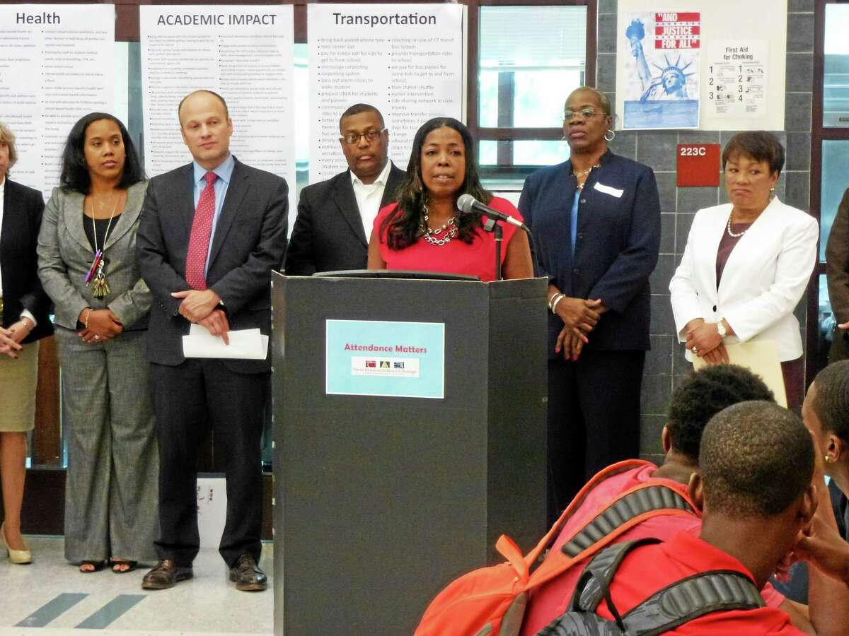 """District Strategy and Coordination Manager Gemma Joseph-Lumpkin is joined by community leaders to discuss the importance of attendance in the lower grades during the official launch of """"Attendance Matters"""" Tuesday in New Haven."""