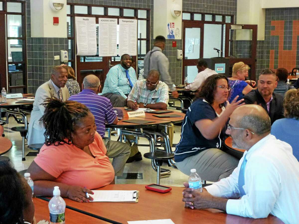 Attendees of the campaign launch were led in an exercise to brainstorm possible ideas to combat chronic absenteeism.