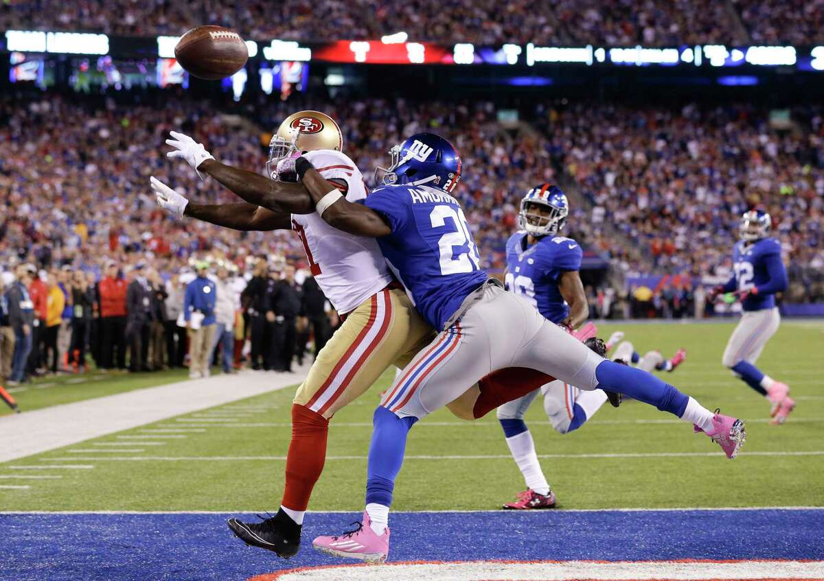 New York Giants cornerback Prince Amukamara (20) breaks up a pass intended for San Francisco 49ers wide receiver Anquan Boldin (81) on Sunday in East Rutherford, N.J.