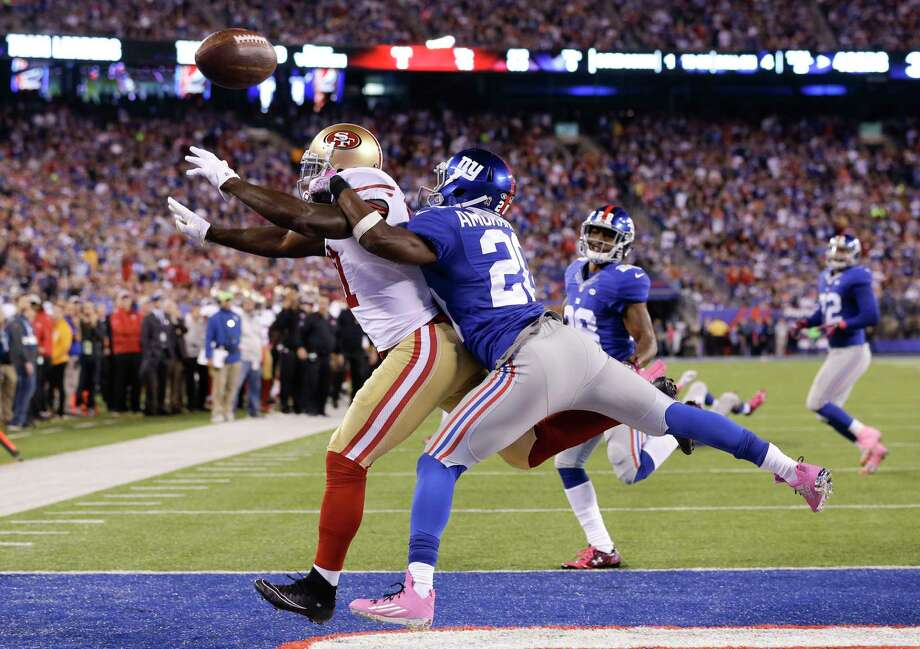 New York Giants cornerback Prince Amukamara (20) breaks up a pass intended for San Francisco 49ers wide receiver Anquan Boldin (81) on Sunday in East Rutherford, N.J. Photo: Seth Wenig — The Associated Press   / AP