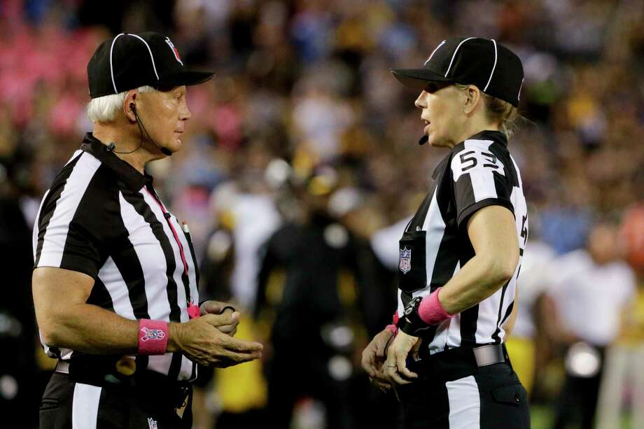 Line judge Sarah Thomas, right, talks with side judge Rob Vernatchi as the Chargers play the Pittsburgh Steelers on Monday in San Diego. Photo: Lenny Ignelzi — The Associated Press   / AP