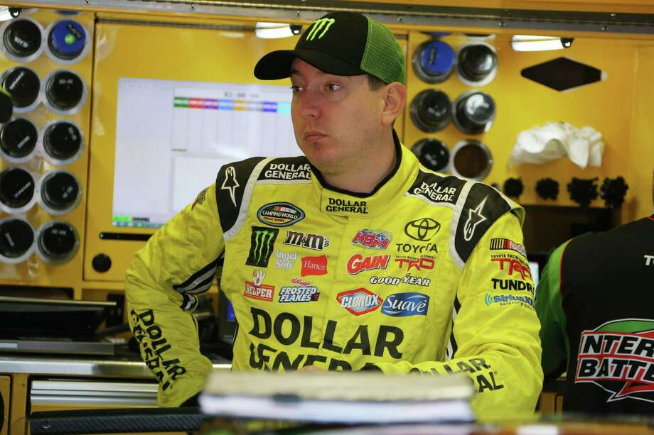 Kyle Busch waits in the garage before a practice session, Saturday, Aug. 15, 2015 for the NASCAR Sprint Cup series auto race at Michigan International Speedway, in Brooklyn, Mich. (AP Photo/Bob Brodbeck) Photo: AP / FR3471 AP