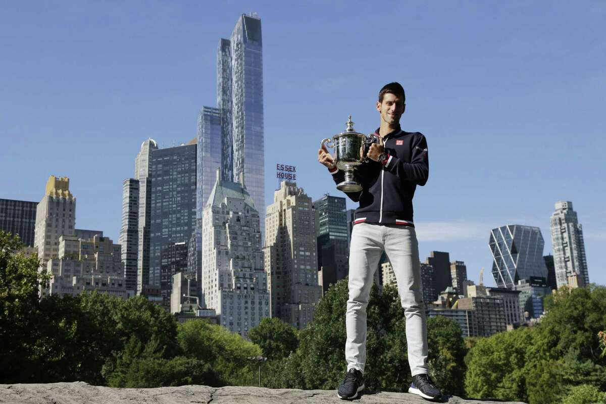 Novak Djokovic poses with the U.S. Open trophy on Monday in New York's Central Park.