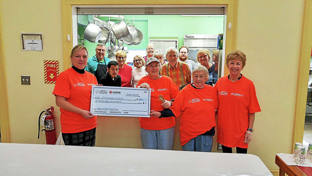 Yvonne Gamelin, RN, of the Healthy West Haven Collaborative presents a check for $700 recently to Alex's Kitchen Volunteers of First Congregational Church of West Haven: Verna Jefferson, Gloria Mazzara, Joyce Anquillare, Janet Kelly, Lou Creller, Joanne Flynn, John and Judy Grammatico, Cheryl and Adam Davidson, Marianne Stern, Allyn Willner and Sherri Torre. Members of the Healthy West Haven Collaborative were expected to be out in force Friday for the Breathe Strong Rally, from 11 a.m. to 4 p.m. at the Cielo Banquet Hall (West Haven Italian-American Club), 85 Chase Lane.