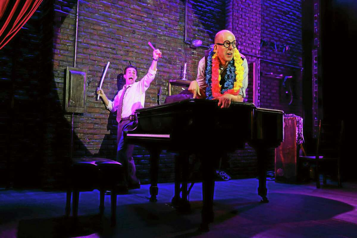 """Both performers sleuth, sing, dance, play piano and jest their way through a 90-minute stoned-cold who-done-it in """"Murder for Two."""""""