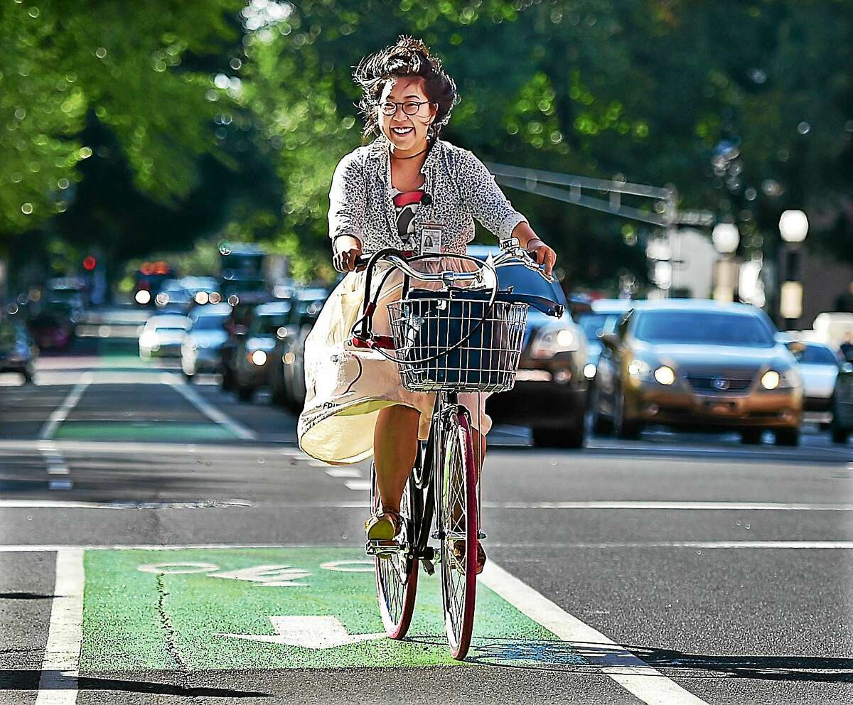 A bicyclist uses a newly-painted bike path on Elm Street in New Haven in August.
