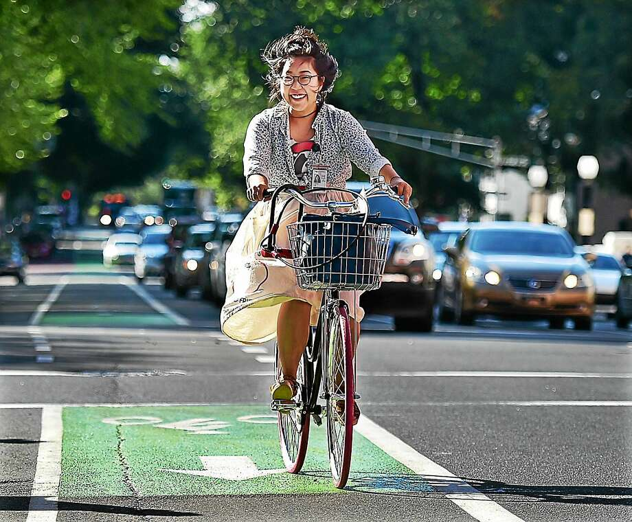 A bicyclist uses a newly-painted bike path on Elm Street in New Haven in August. Photo: Catherine Avalone — New Haven Register FILE PHOTO   / New Haven RegisterThe Middletown Press