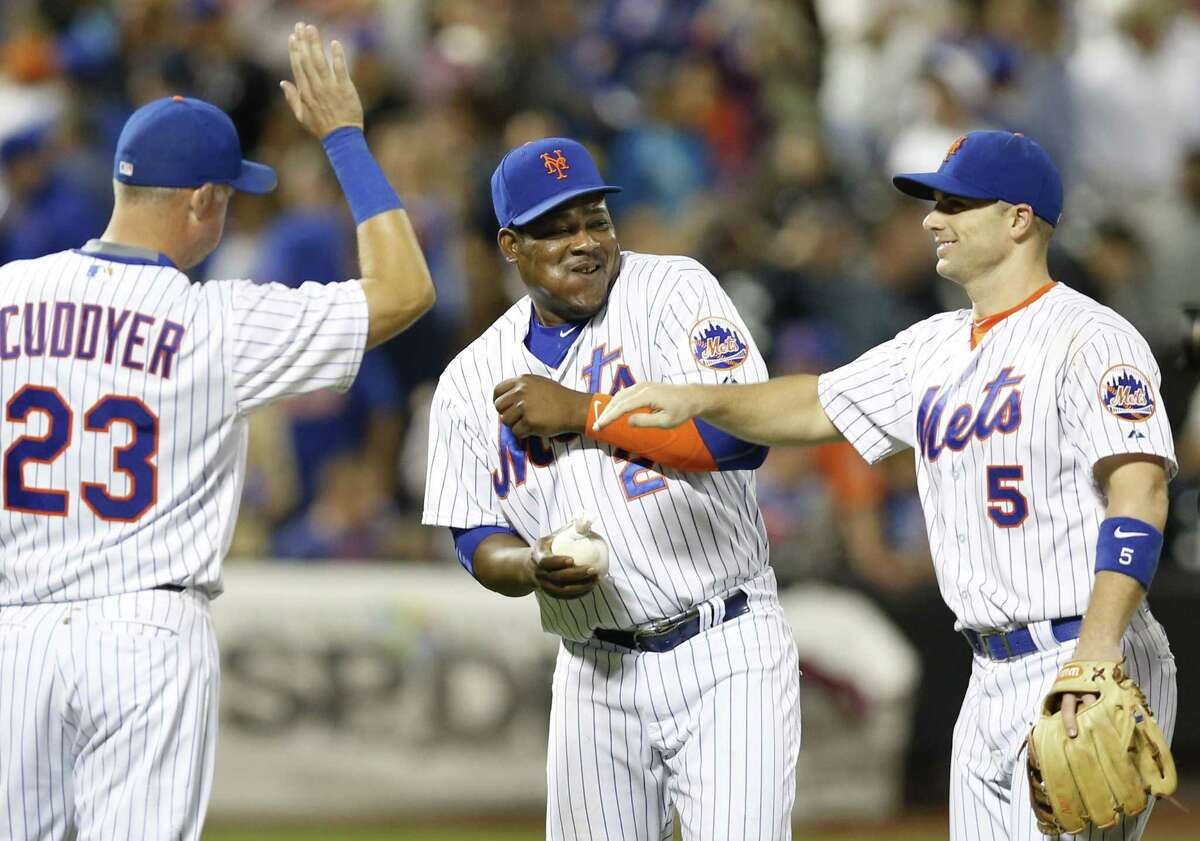 The Mets' Michael Cuddyer (23) second baseman Juan Uribe (2) and third baseman David Wright celebrate the Mets' 4-3 victory over the Marlins on Monday.