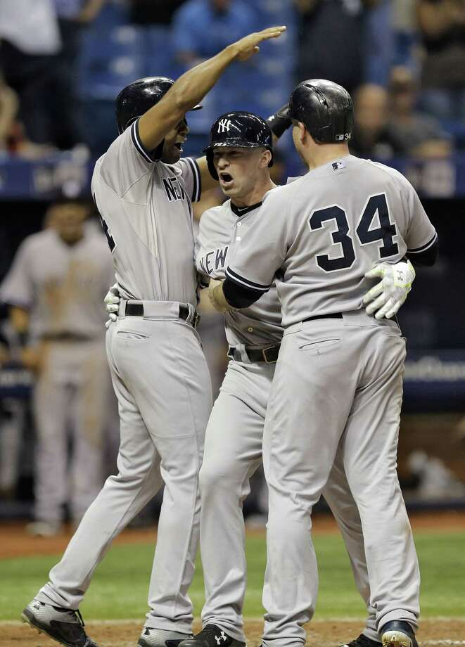 The Yankees' Slade Heathcott, center, celebrates his three-run home run in the ninth inning on Monday. Photo: Chris O'Meara — The Associated Press   / AP