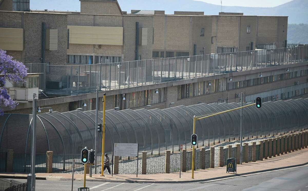 This Tuesday, Oct. 21, 2014, file photo shows the Kgosi Mampuru Correctional Services prison in Pretoria, South Africa where Oscar Pistorius has been kept since his imprisonment for killing his girlfriend Reeva Steenkamp. South Africa's Department of Corrections says a parole board has decided that Oscar Pistorius can be released from prison and moved to house arrest on Tuesday, Oct, 20 2015. The parole board made the decision Thursday, Oct. 15, 2015 after an initial decision to release the double-amputee runner in August was canceled.