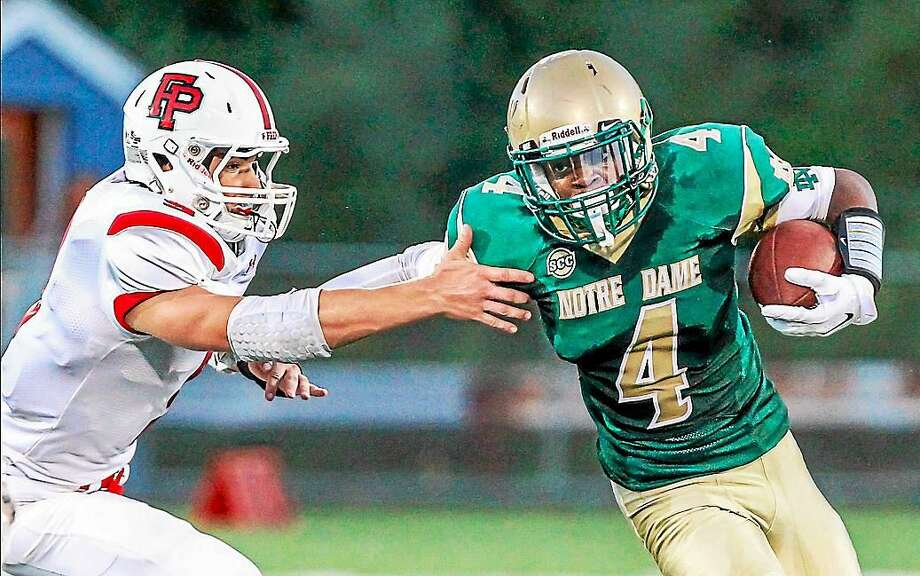 Notre Dame-West Haven's offense and defense put up big showings in the Green Knights' opener against Fairfield Prep. Performances like that of senior running back Kobe Wiggins (No. 4) helped them secure a 34-0 victory. Photo: Photo John Vanacore -- GameTime CT