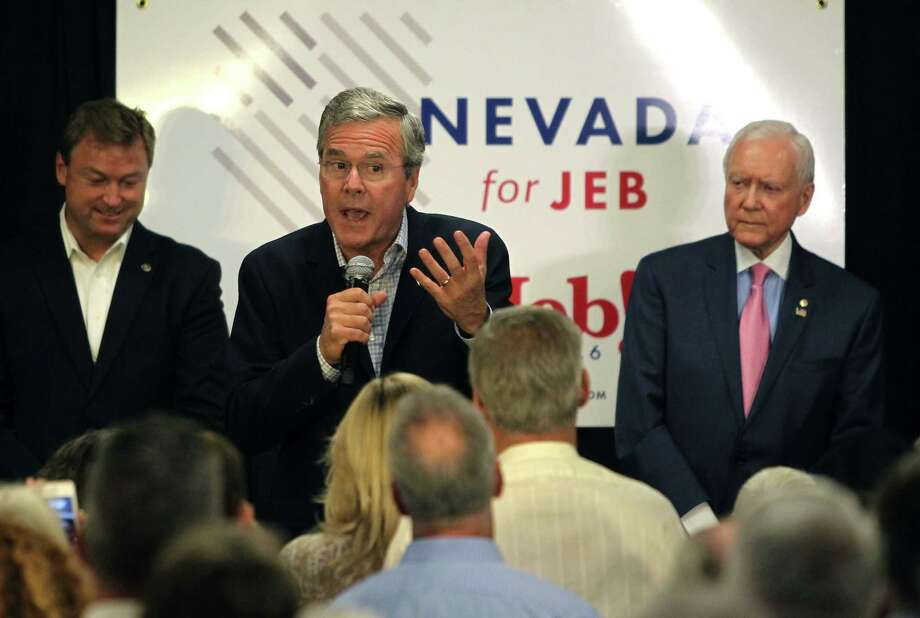 Nevada Republican Sen. Dean Heller, left, and Utah Republican Sen. Orrin Hatch, right, listen to Republican presidential candidate Jeb Bush, center, speak after endorsing Bush, during a campaign stop Wednesday in Reno Nev. Photo: AP Photo   / FR171256 AP