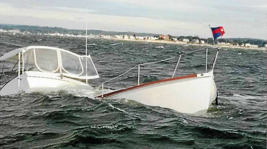 Photo courtesy of the Old Saybrook Fire Department  Two people were rescued after their boat sank Monday morning in the Long Island Sound near Old Saybrook. The pair were rescued by the Plum Island ferry and were reportedly unhurt. Photo: Journal Register Co.