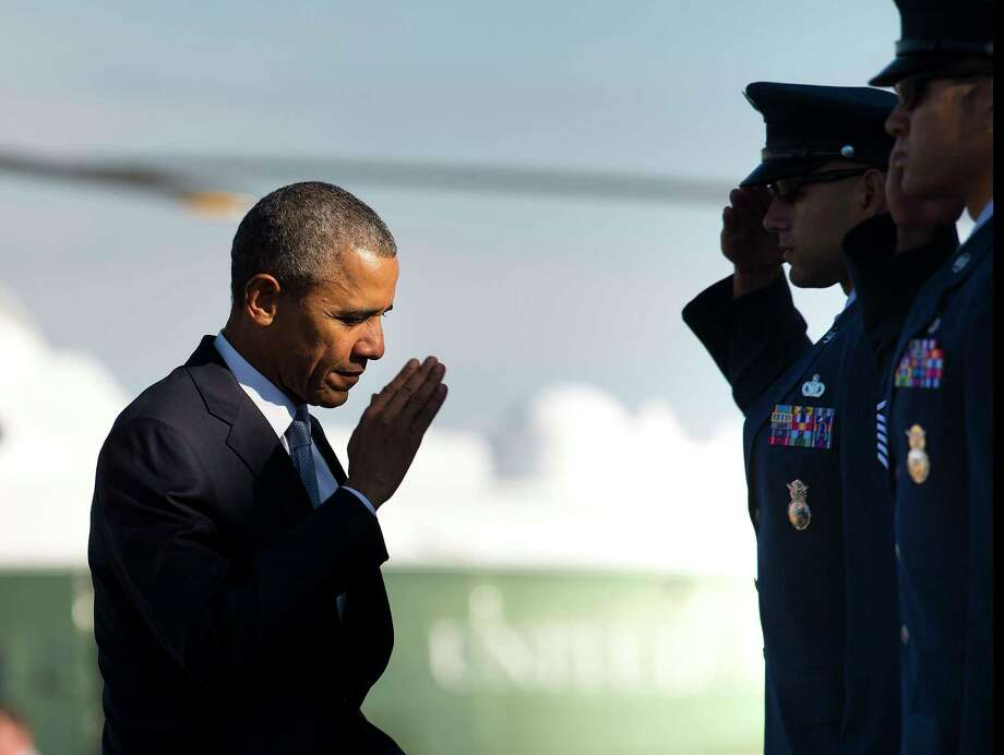 In this Oct. 9, 2015 photo, President Barack Obama returns a salute prior to boarding Air Force One before his departure from Andrews Air Force Base, Md. Obama will keep 5,500 U.S. troops in Afghanistan when he leaves office in 2017, according to senior administration officials, casting aside his promise to end the war on his watch and instead ensuring he hands the conflict off to his successor. Photo: AP Photo/Pablo Martinez Monsivais, File   / AP