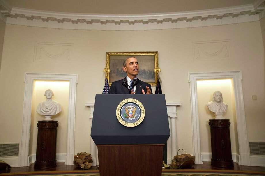 President Barack Obama speaks Saturday about the Paris climate agreement from the Cabinet Room of the White House in Washington. Photo: Associated Press   / AP