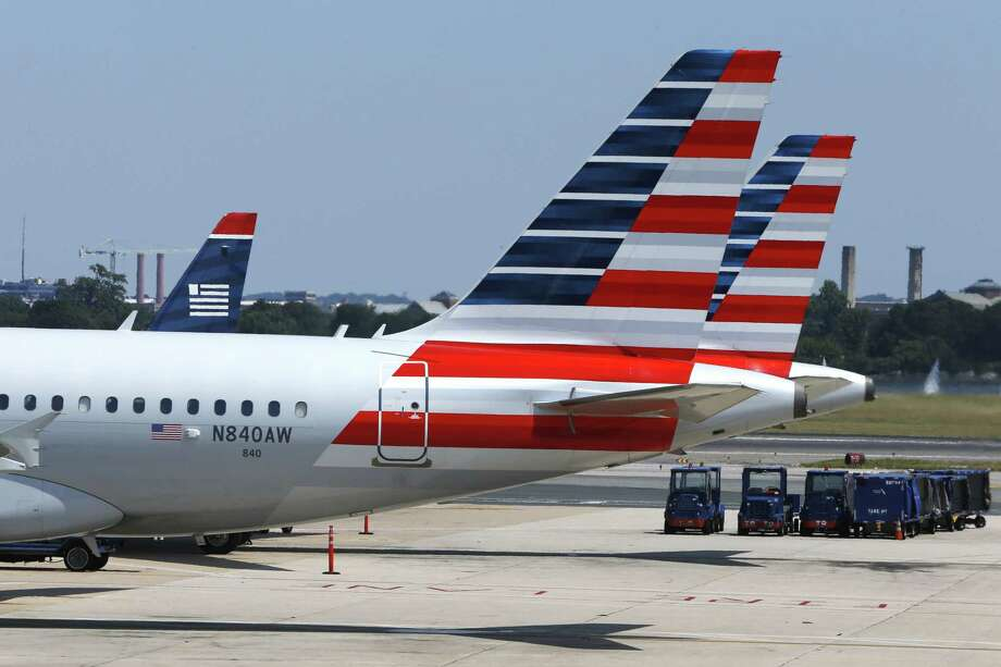 American Airlines planes wait on the tarmac at Washington's Reagan National Airport after technical issues at a Federal Aviation Administration center in Virginia caused delays on Saturday, Aug. 15, 2015. Photo: AP Photo/Jacquelyn Martin / AP
