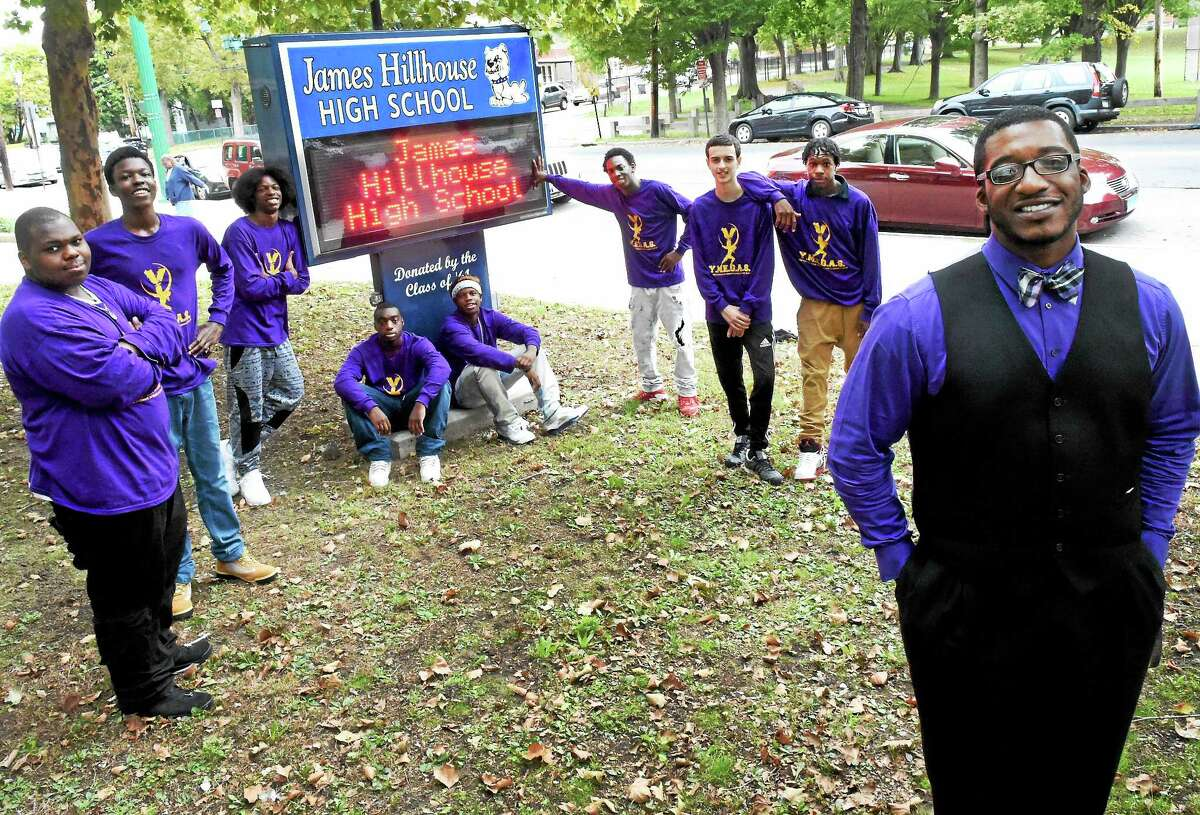 Olafemi Hunter, James Hillhouse High School counselor and administrator of the I.D.E.A. Academy, far right, with students, from left, Dashawn Holmes, Jahni More, Tyrelle Douglass, Carl Jones, Messiyah McDuffie, Kevin Bell Jr., Jacob Fonton and Raheem Kearson in front of Hillhouse in New Haven.