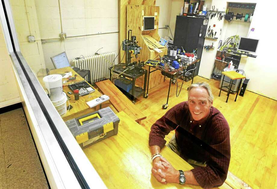 Dave Bennett, a Hamden Hall science teacher and director of the school's MakerSpace Design Lab, sits in a section of the lab that includes a 3D printer Thursday. Photo: Peter Hvizdak — New Haven Register   / ©2015 Peter Hvizdak