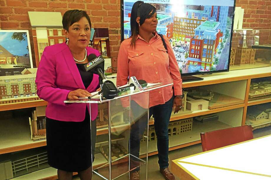 New Haven Mayor Toni Harp, left, address the media during a press conference concerning New Haven Veterans Memorial Coliseum site redevelopment Thursday. At right is Board of Alders President Tyisha Walker. Photo: Esteban L. Hernandez — New Haven Register