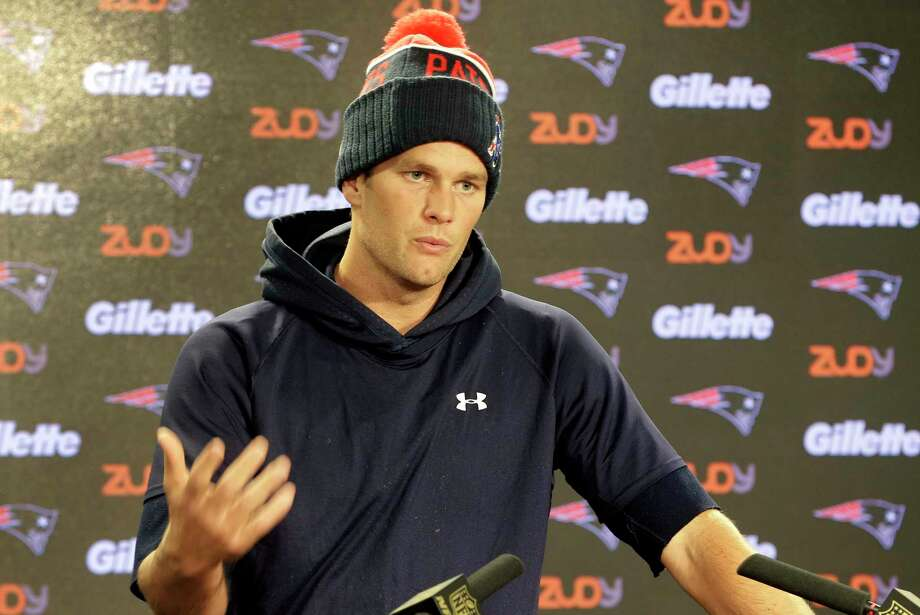 New England Patriots quarterback Tom Brady faces reporters before practice Wednesday in Foxborough, Mass. Photo: Steven Senne — The Associated Press   / AP