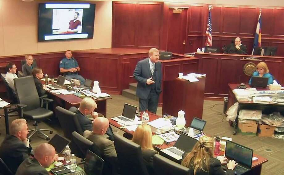 In this image taken from video, accused Colorado theater shooter James Holmes, on the upper far left, listens to defense attorney Daniel King give closing arguments during his trial, in Centennial, Colo., Tuesday, July 14, 2015. (Colorado Judicial Department via AP, Pool) Photo: AP / POOL Colorado Judicial Department