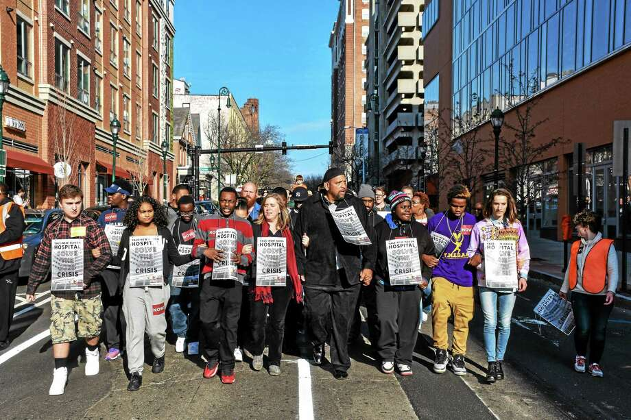New Haven residents march from downtown to Yale-New Haven Hospital Saturday to call on the hospital to solve the jobs crisis. (Contributed photo) Photo: Journal Register Co.