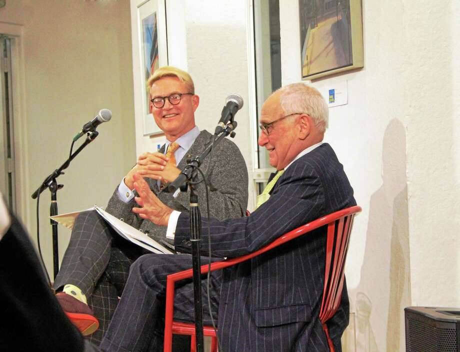 Yale Deputy Chief Communications Officer Michael Morand, left, and Robert A.M. Stern, dean of the Yale School of Architecture, right, talk at Creative Arts Workshop on Dec. 10. Photo: Katrina Goldburn — For The Register