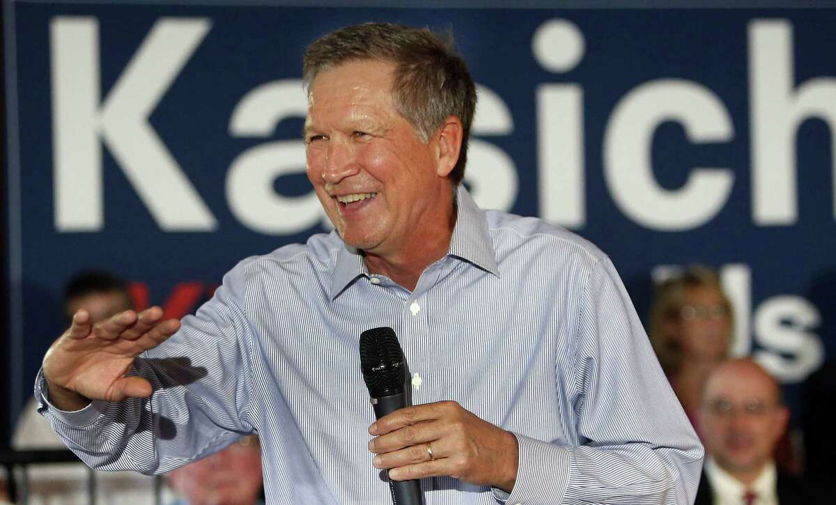 In this Aug. 12, 2015, photo, Republican presidential candidate, Ohio Gov. John Kasich speaks to a packed crowd during a campaign stop at the VFW in Derry, N.H. Even at his own rallies, Kasich is a stranger to some New Hampshire voters. Even as a mystery, Kasich has emerged as a threat to his better-known Republican rivals. He is among those betting they can capitalize on New Hampshireís tendency to favor pragmatists over ideologues.