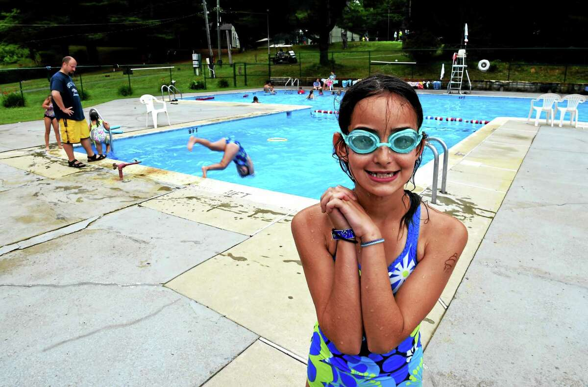 Camper Janessa White, 9, right, takes part in a diving class at Camp Laurelwood in Madison,