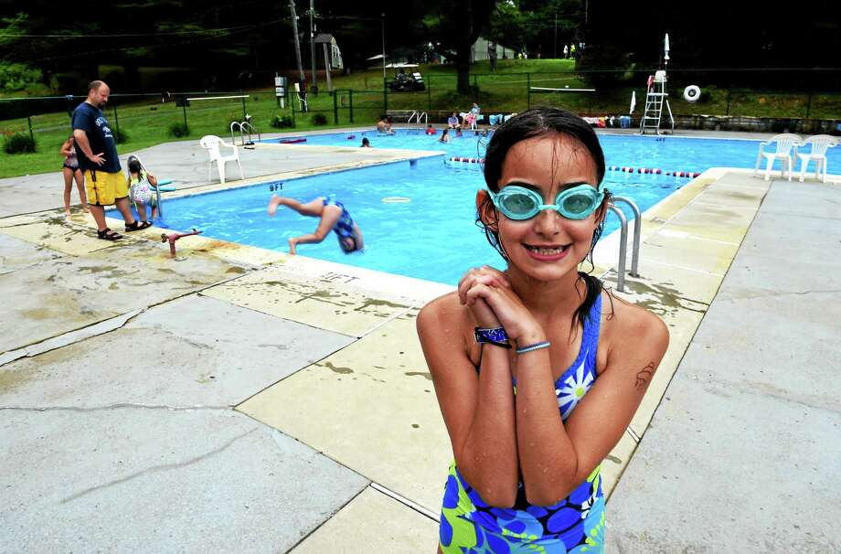 Camper Janessa White, 9, right, takes part in a diving class at Camp Laurelwood in Madison, Photo: Peter Hvizdak — New Haven Register   / ©2015 Peter Hvizdak