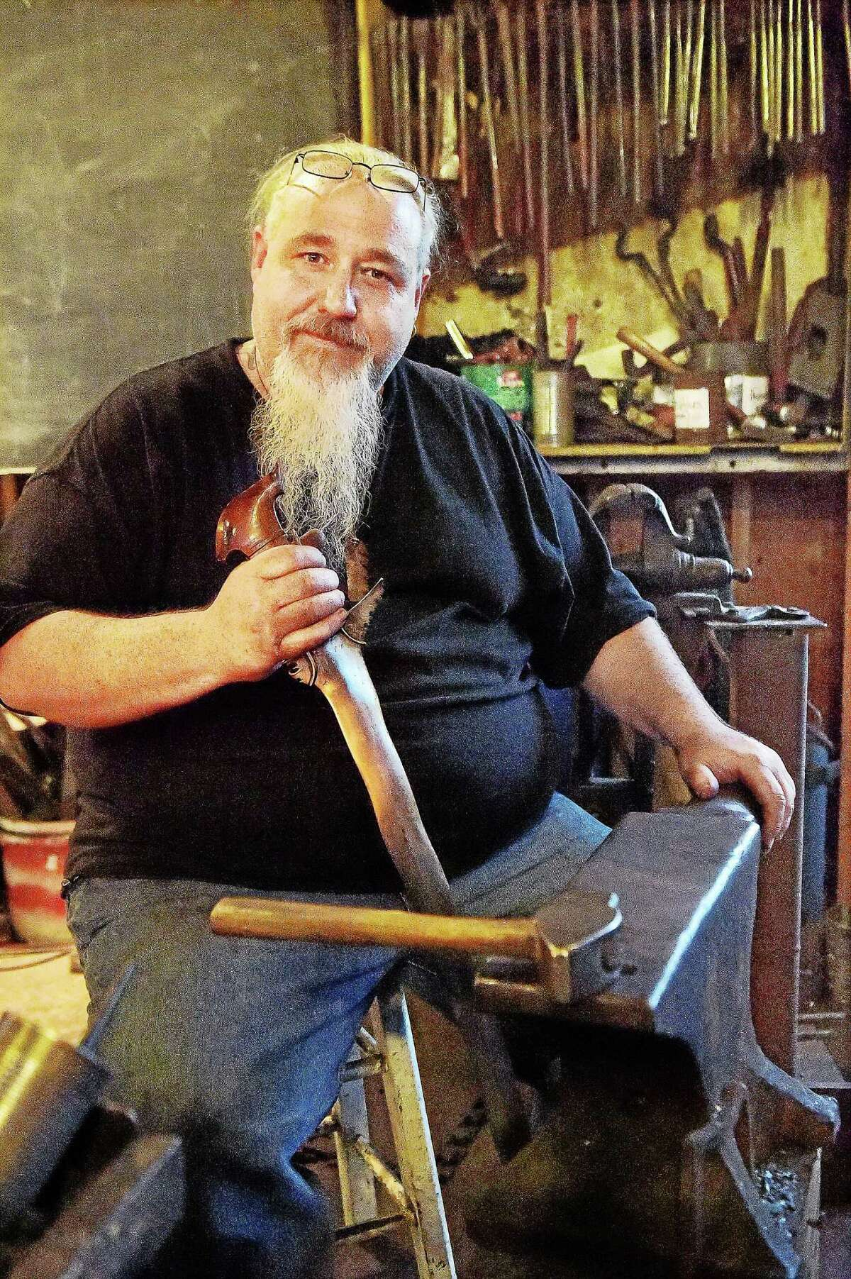 Guilford bladesmith Mace Vitale, rated Journeyman smith with the American Bladesmith Society and owner of Laurel Rock Forge , is photographed Wednesday, August 13, 2015, at the Guilford Art Center where he teaches Blacksmithing. Vitale holds an antique Phillipine version of the Kris Sword, similar to the Moro Kris Sword he made when he won the History Channel's Forged in Fire.