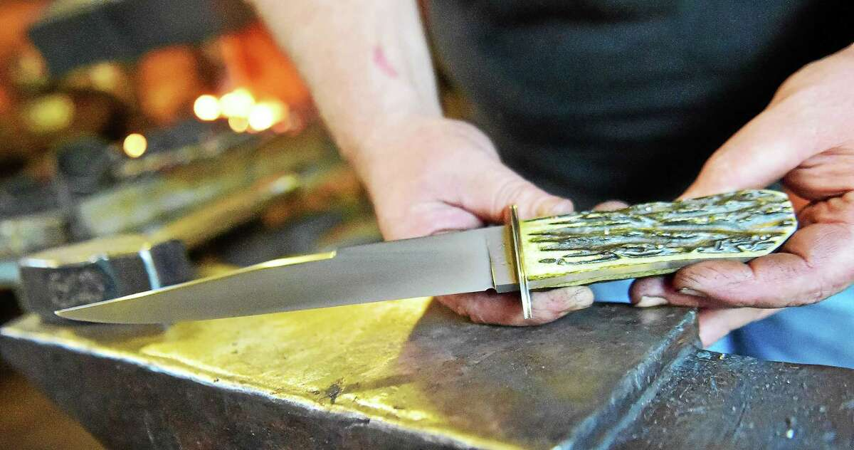 A knife handcrafted by Guilford bladesmith Mace Vitale at the Guilford Art Center, Wednesday, August 13, 2015. Vitale won the History Channelís Forged in Fire. (Catherine Avalone/New Haven Register)