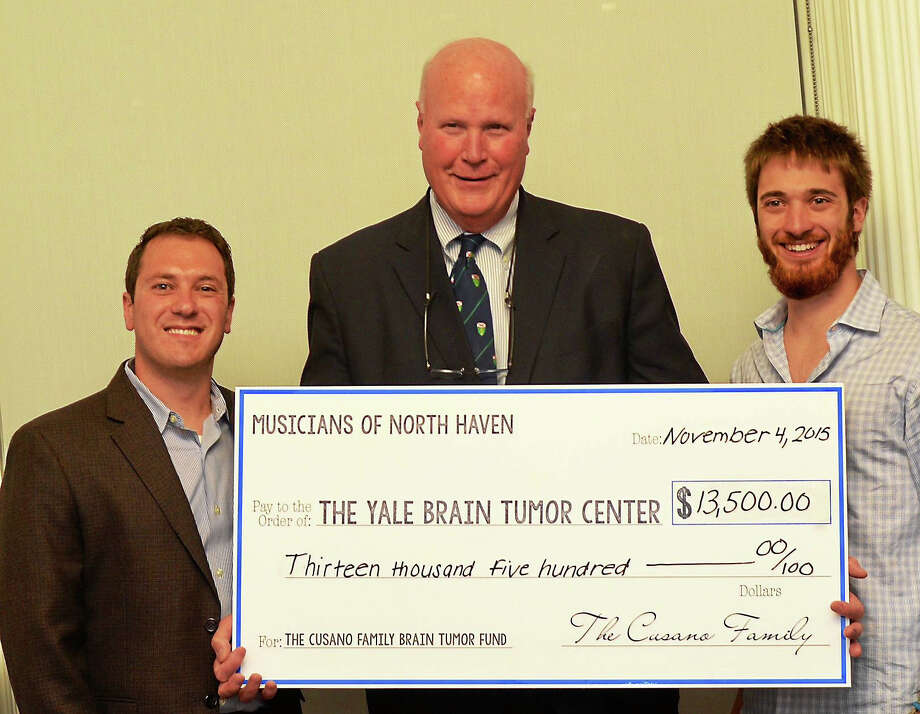 Left to right, Christopher Cusano, Dr. Joseph Piepmeier, and Stephen Cusano with a check to the Yale Brain Tumor Center. Photo: CONTRIBUTED PHOTO