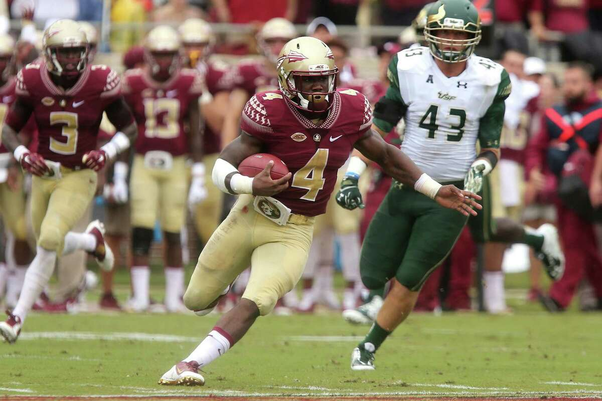 Florida State's Dalvin Cook, center, scampers 74 yards for a touchdown against South Florida on Saturday.