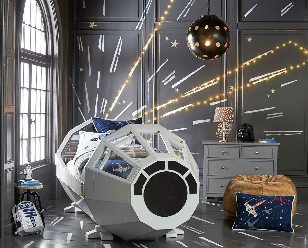 This photo provided by Pottery Barn Kids shows a Star Wars Millennium Falcon bed ($3,999).