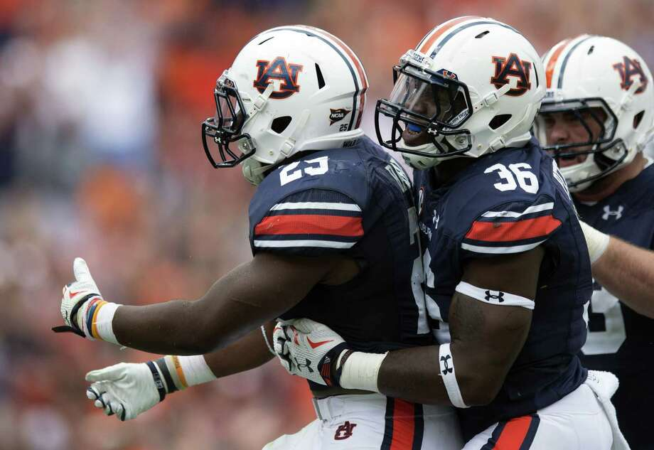 Auburn Tigers running back Peyton Barber (25) celebrates with full back Kamryn Pettway (36) after scoring the winning touchdown against Jacksonville State on Saturday. Photo: Albert Cesare — The Montgomery Advertiser Via AP   / The Montgomery Advertiser