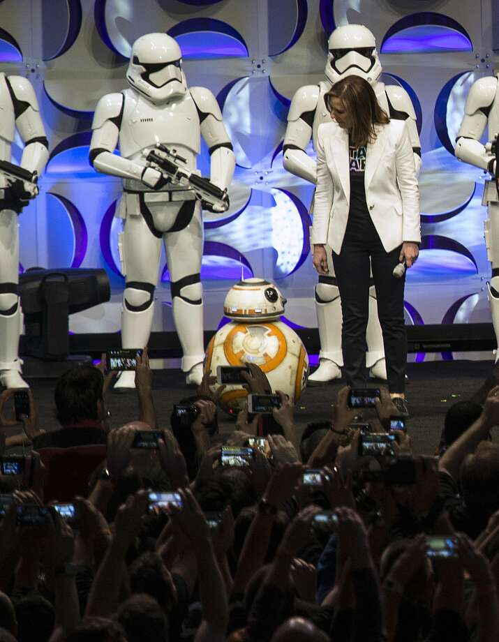 "Producer Kathleen Kennedy, right, looks down at the BB-8 droid, featured in the upcoming film, ""Star Wars: The Force Awakens,"" during the Star Wars Celebration at the Anaheim Convention Center in Anaheim, Calif. Photo: Ed Crisostomo — The Orange County Register Via AP   / The Orange County Register"